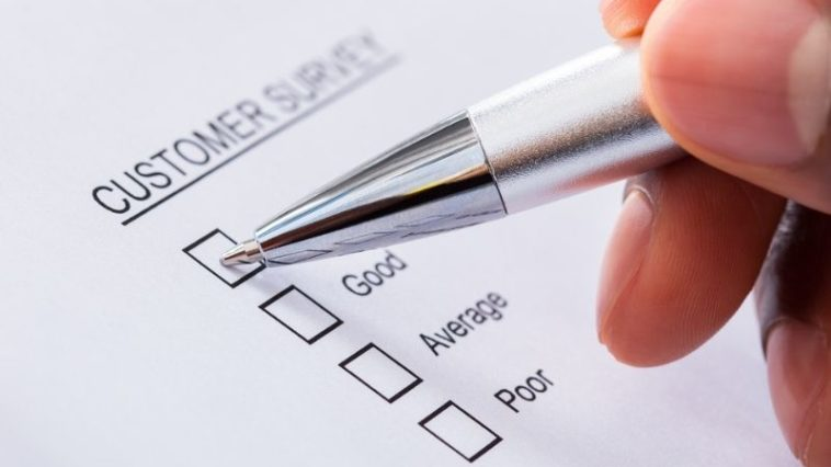 person filling up customer survey